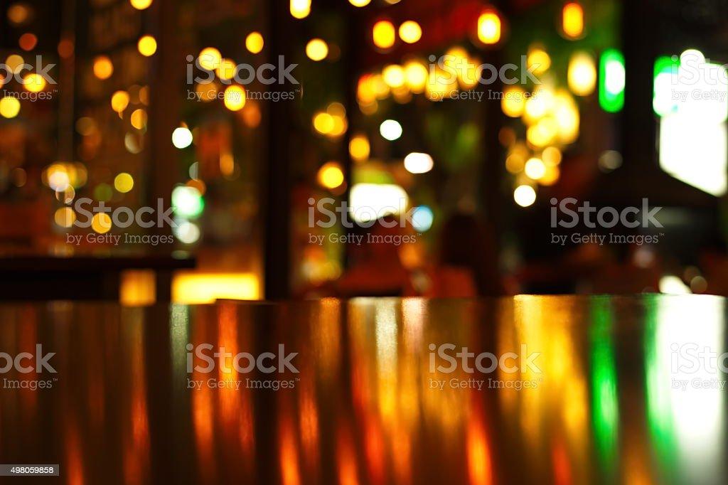blur bokeh light reflection on bar table stock photo