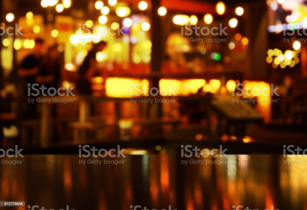 blur bokeh reflection light on table in pub or bar club and restaurant Christmas party and celebrate in the dark night stock photo