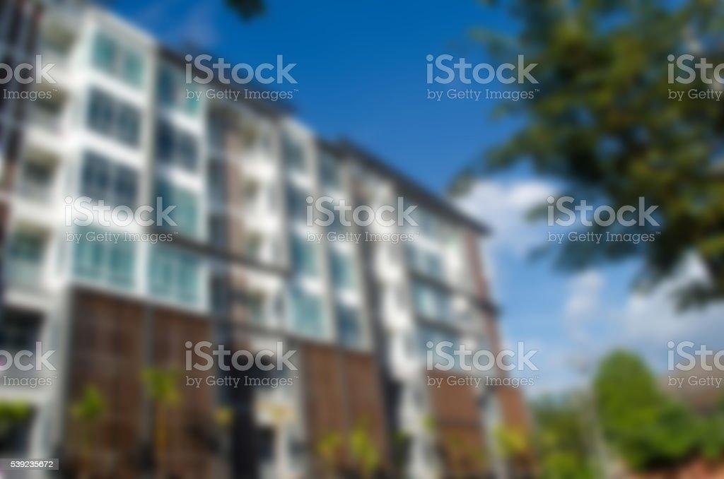 Blur building housing the people present. foto de stock libre de derechos
