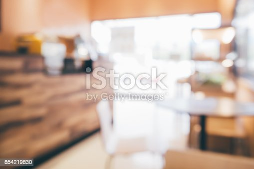 886308526 istock photo blur cafe coffee shop restaurant interior abstract background 854219830