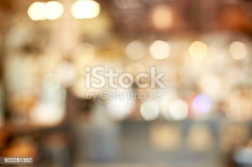 istock Blur  cafe restaurant with abstract bokeh light image background 920281352