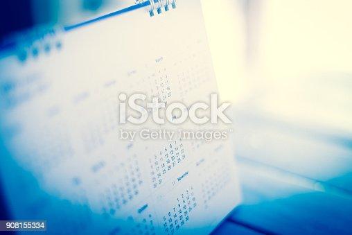 istock blur calendar in blue tone. 908155334