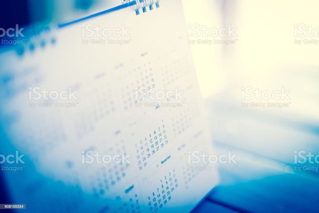 blur calendar in blue tone. stock photo