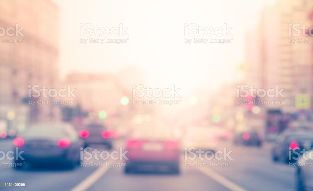 Blur cars on the road with smooth traffic at junction area. Cars stop...