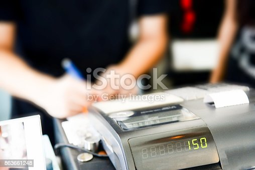 istock Blur cashier counter in the supermarket,Cashier at a supermarket checkout in a department store 863661248