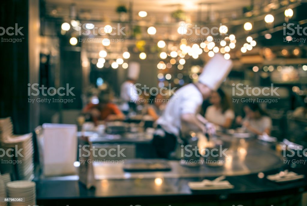 Blur chef cooking in restaurant with  customer - foto stock