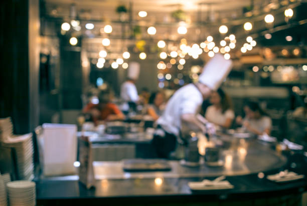 blur chef cooking in restaurant with  customer - busy restaurant kitchen stock pictures, royalty-free photos & images