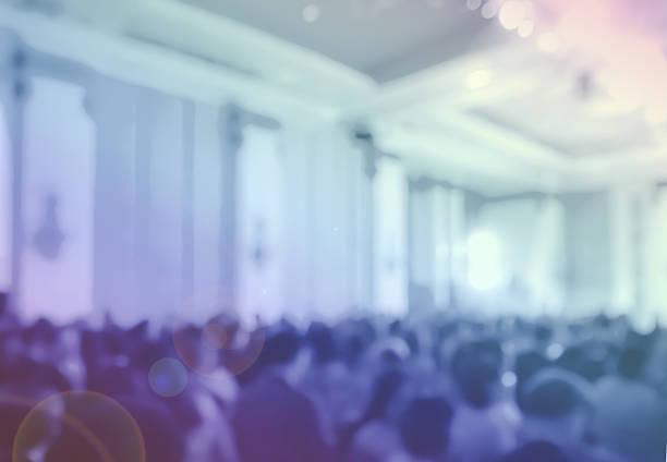 blur clouded customers in hotel ballroom and monitor at night - eventos de gala - fotografias e filmes do acervo