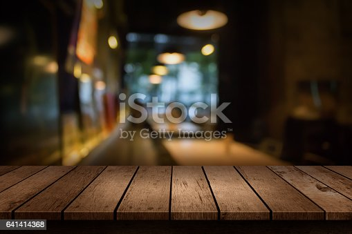 istock Blur coffee shop or cafe restaurant with abstract bokeh light background. For create montage product display 641414368