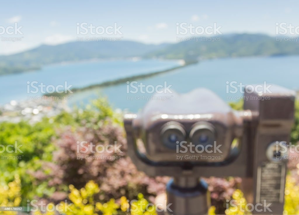 Blur coin operated binoculars viewer machine for tourist ,blur background stock photo
