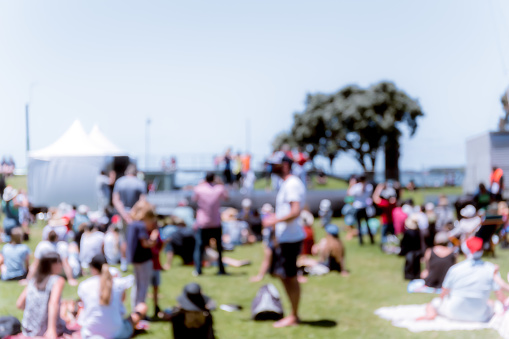 Blur Defocused Background Of People In Park Stock Photo - Download Image Now