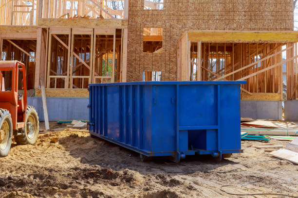 Blur dumpster, recycle waste and garbage bins near new construction site of appartment houses building stock photo