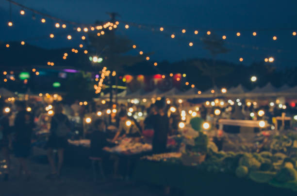 Blur Festival Food Blur Festival food festival as a background image of the product. night market stock pictures, royalty-free photos & images