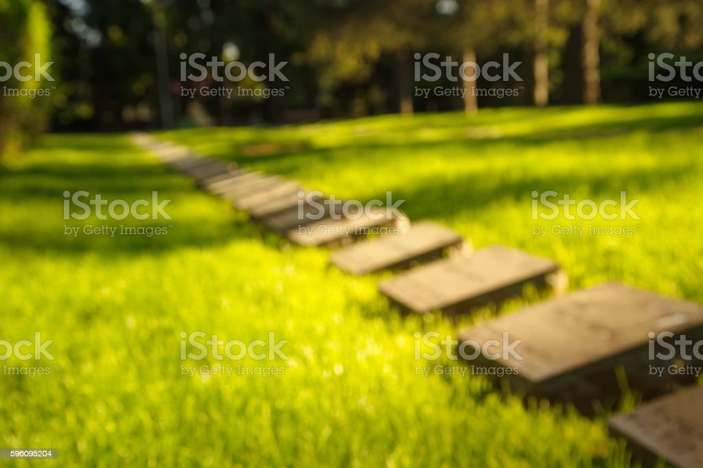 blur graves in green park royalty-free stock photo