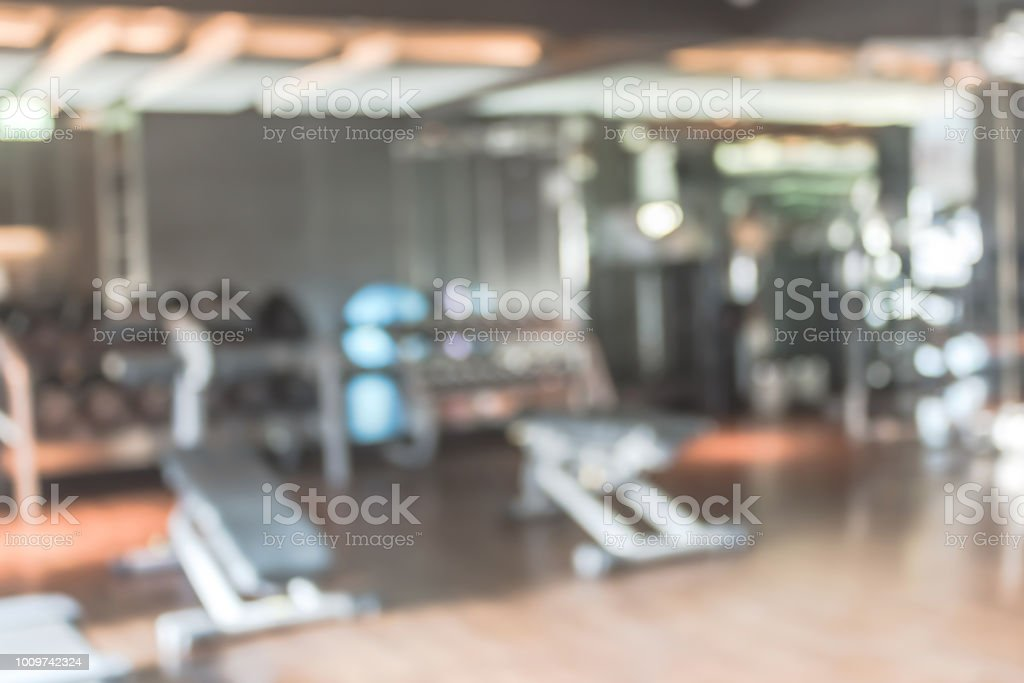 Blur gym background fitness center or health club with blurry sports...