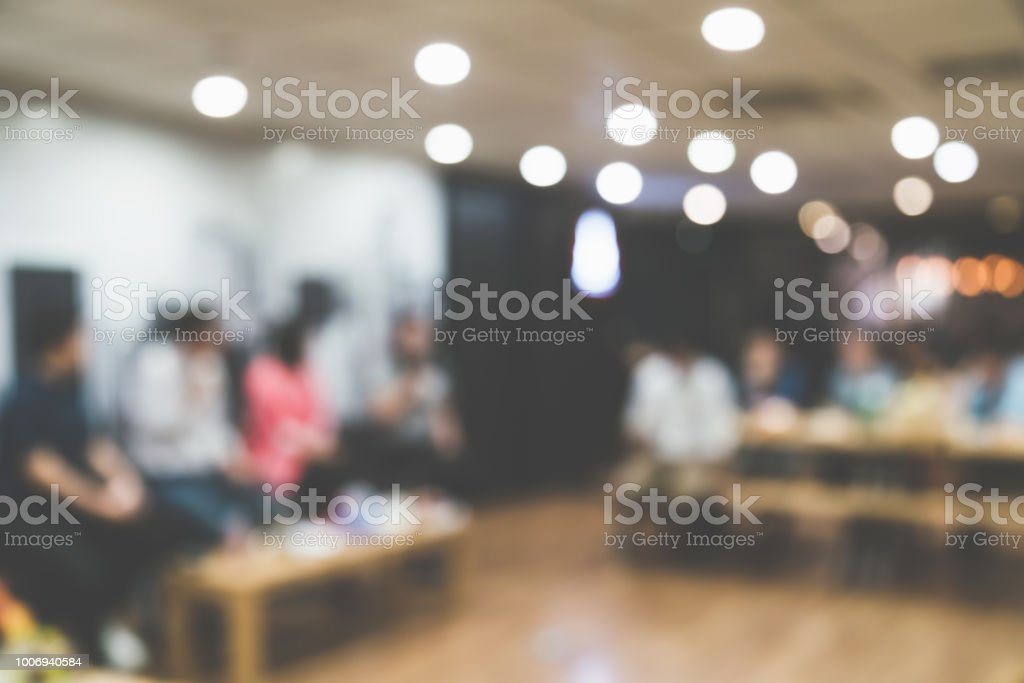 blur image background room of crowd group people standing seminar