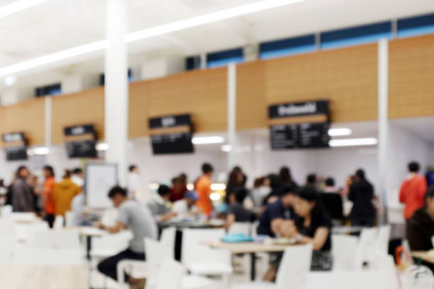 blur image canteen dining hall room, a lot of people are eating food in university canteen blur background, blurred background cafe or cafeteria - asian with phone house background stock photos and pictures