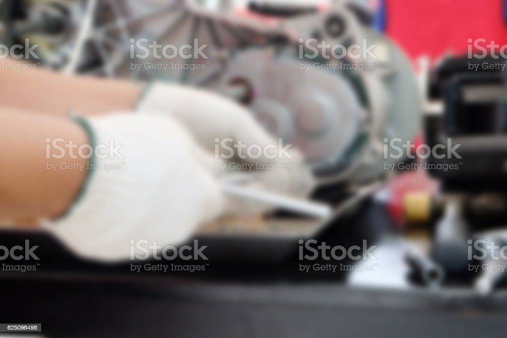 Blur image hands of disassembly kit motorcycle in repair service. stock photo