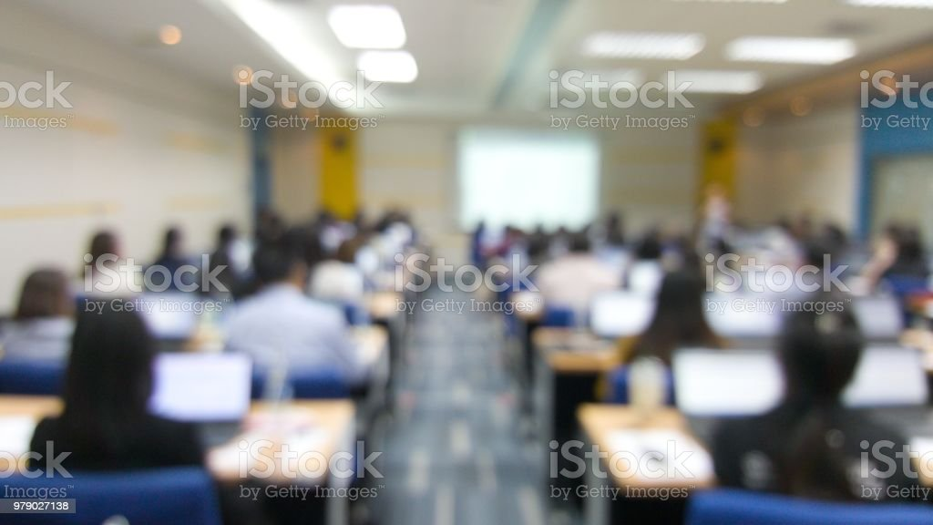 Blur image of many people are training in the big training room with computer. stock photo