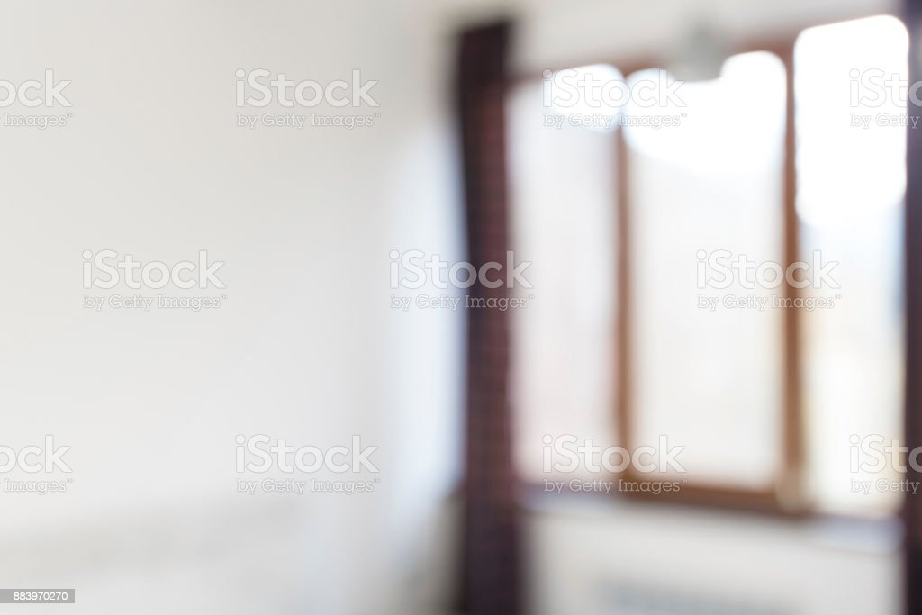Blur image of modern living room with white wall and window, interior stock photo