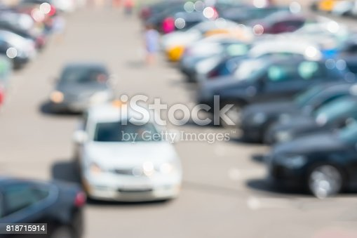 istock Blur image of parking next to modern shopping mall at peak hour. Cars leave parking lot, sales retail, season sales 818715914