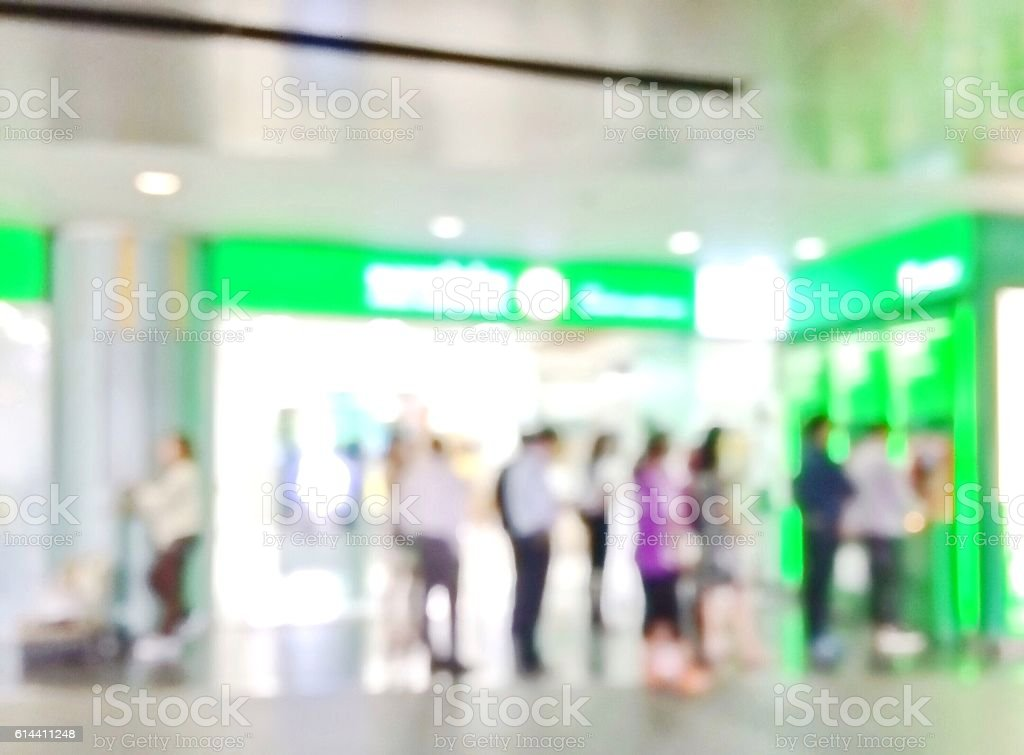Blur image of people queue at automatic teller machine (ATM) stock photo