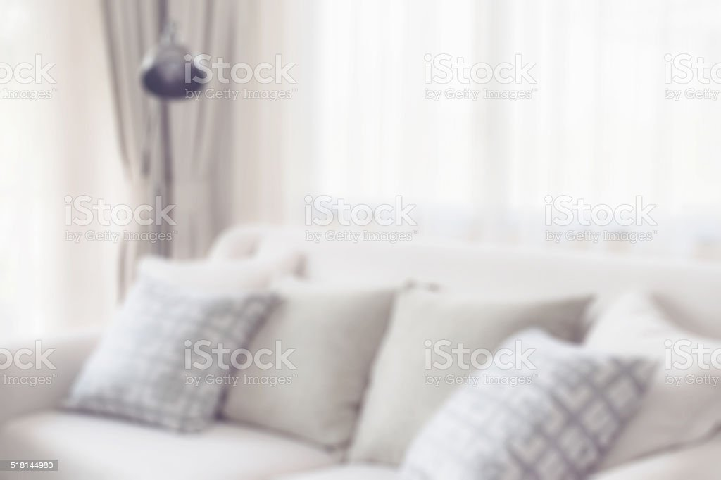 blur image of pillows on sofa in modern living room stock photo
