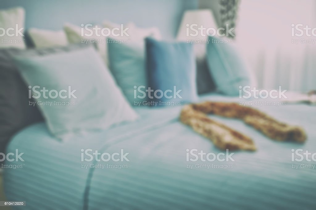 blur image of scarf on bed in blue scheme bedding stock photo