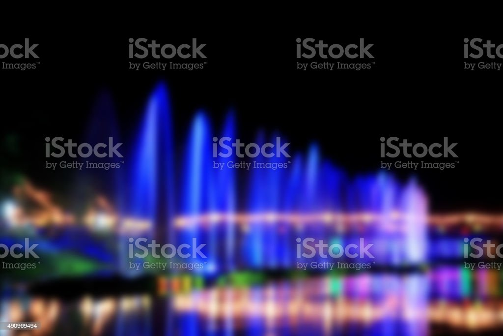 blur image. Water fountains on night background in Thailand. Dan stock photo