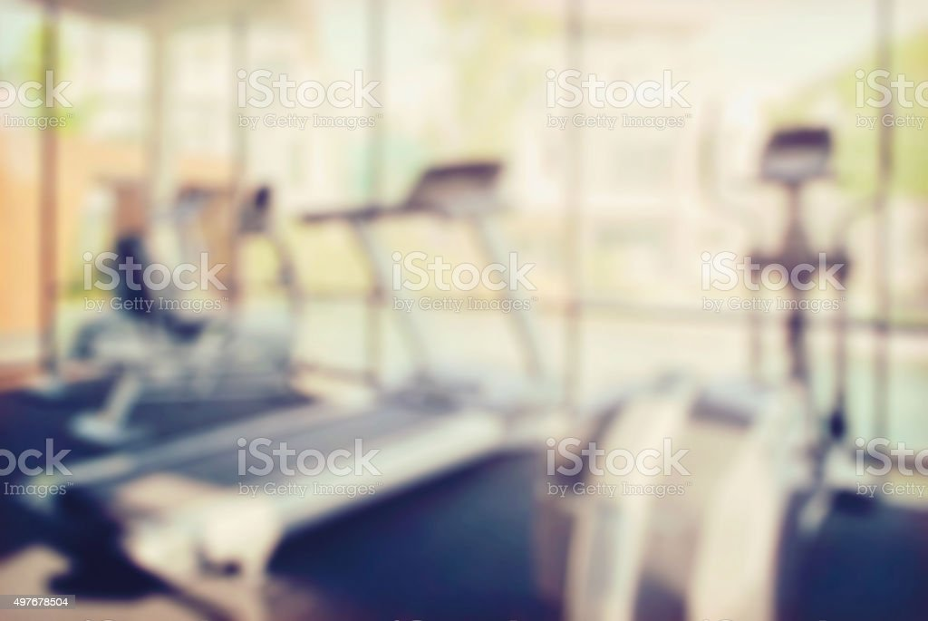 blur interior of modern fitness center gym with equipment stock photo