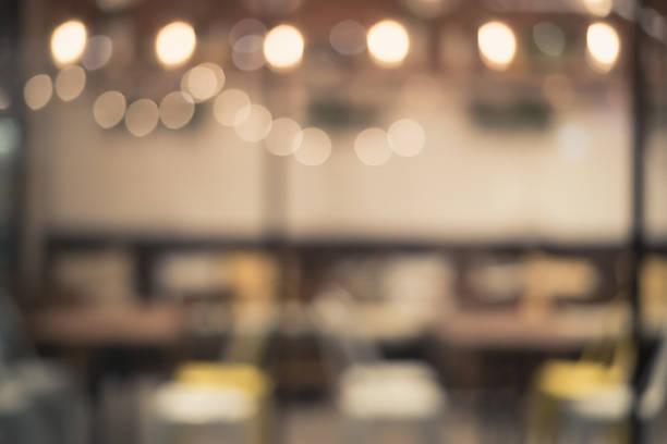 weichzeichnen licht in das restaurant für hintergrund - kaffee shop stock-fotos und bilder