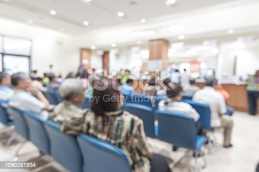 Blur medical background clinic service counter lobby with patient paying bill at cashier desk  in hospital