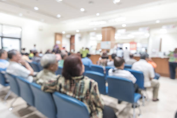 blur medical background clinic service counter lobby with patient paying bill at cashier desk  in hospital - fare la fila foto e immagini stock