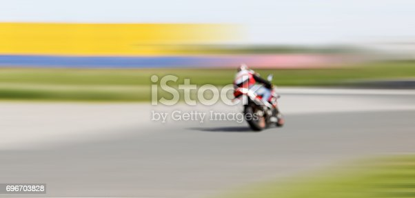 istock Blur motion of motorcycle racer on a track 696703828