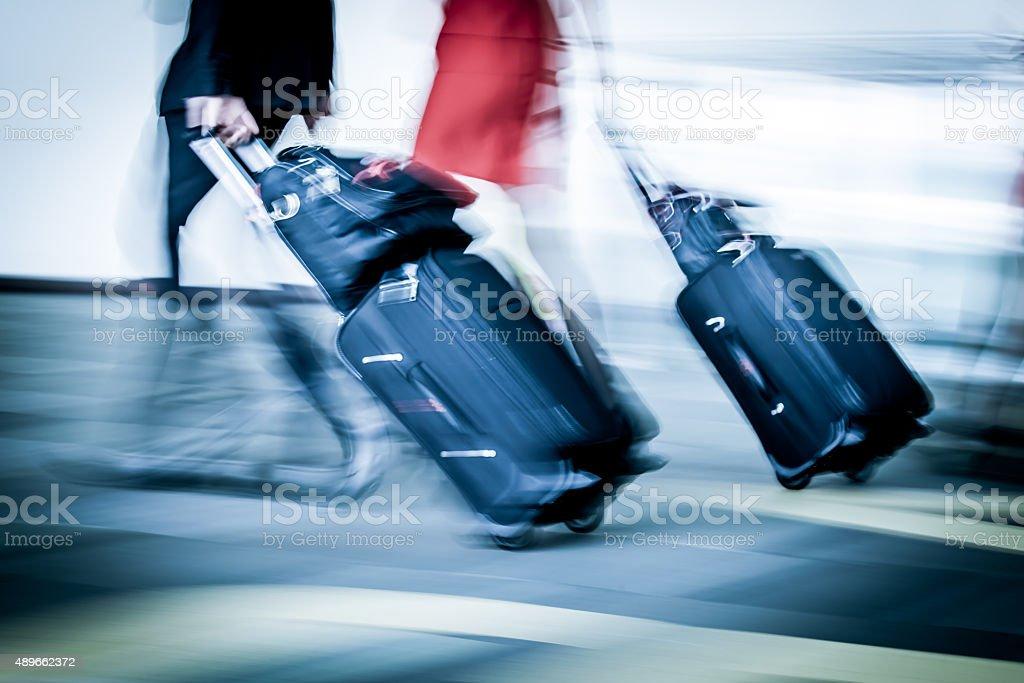 Blur motion of passengers walking at airport stock photo