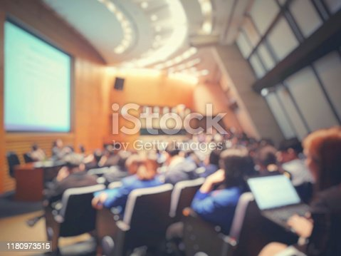 491577806 istock photo Blur of auditorium room use for present meeting background. 1180973515