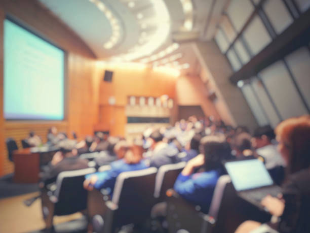blur of auditorium room use for present meeting background. - fundo oficina imagens e fotografias de stock