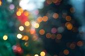 Blur of christmas tree with lighting in dark