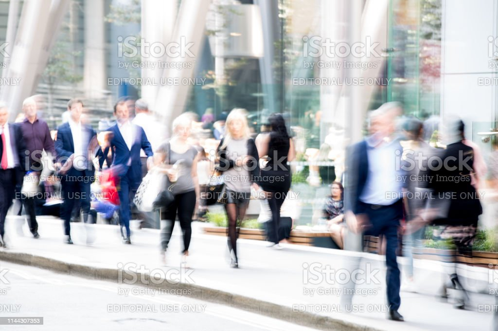 Blur Of Group Business People Walking In The City Of London