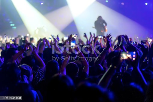 blur of People shooting video or photo in music brand showing on stage or Concert Live, party concept