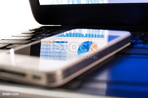 istock Blur of reflect business graph on smartphone.Analysis/financial concept 848814200