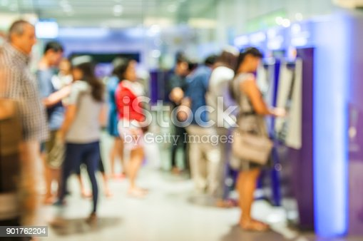istock Blur or Defocus Background of People line up to use Banking Machine or ATM(Automatic Teller Machine) to Deposit, Withdraw and Transfer Money, Bangkok Thailand 901762204
