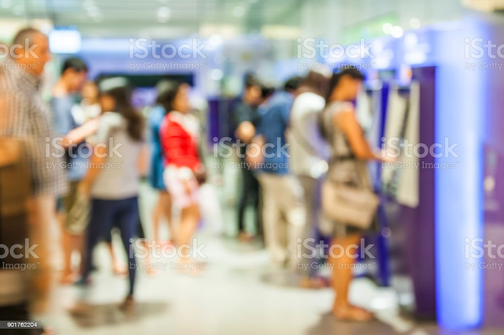 Blur or Defocus Background of People line up to use Banking Machine or ATM(Automatic Teller Machine) to Deposit, Withdraw and Transfer Money, Bangkok Thailand stock photo