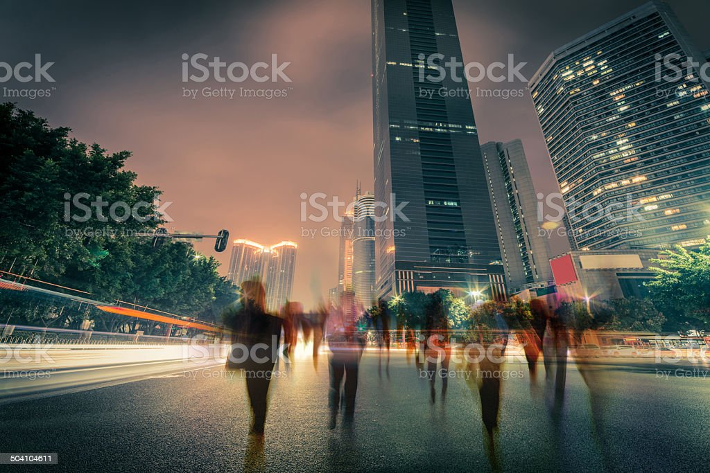 blur people and traffic on a street at night stock photo
