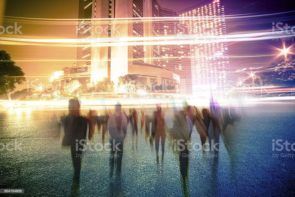 blur people and traffic on a street at night royalty-free stock photo