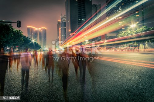 istock blur people and traffic on a street at night 504105305