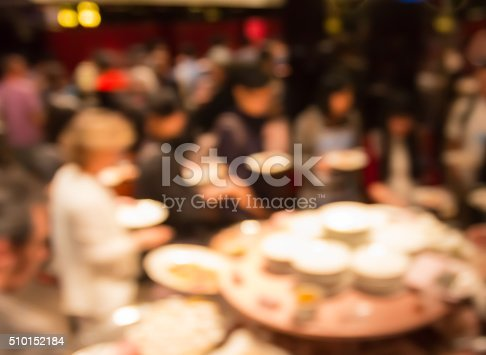 istock blur people at  dinner party in dining room 510152184