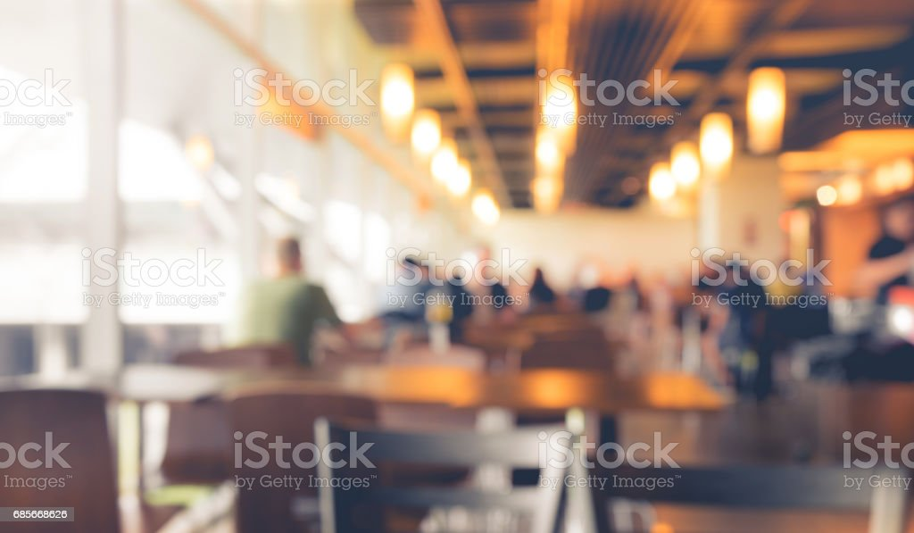 Blur people in cafe,restaurant with light bokeh background.