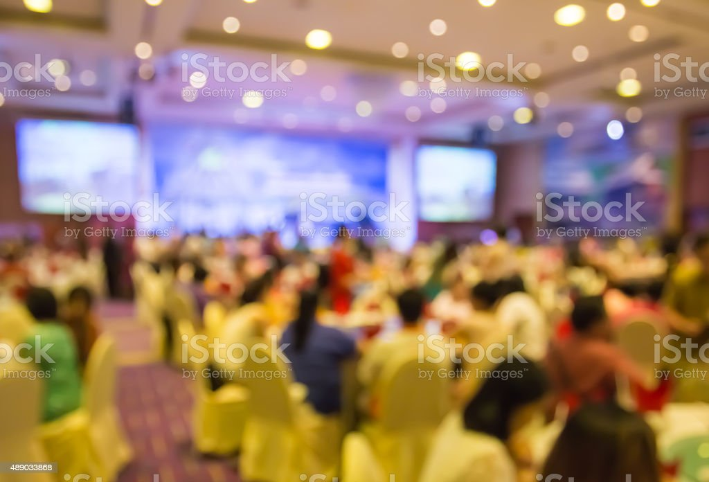 blur people  sitting in dining room with projecting monitor stock photo