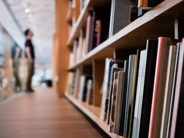 Blur People stand Book shelf in Public Library stock photo